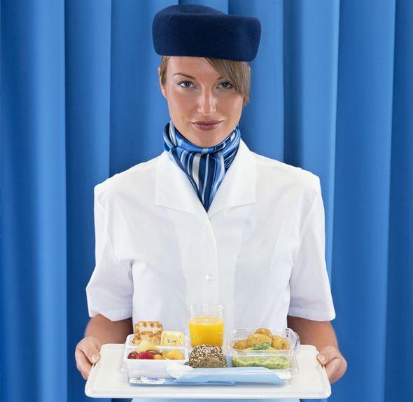 Flight attendant serving food